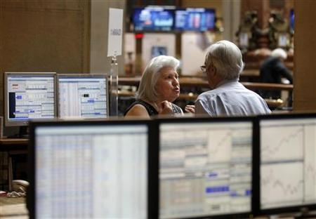 A woman gestures at the stock exchange in Madrid, June 8, 2012. REUTERS/Andrea Comas