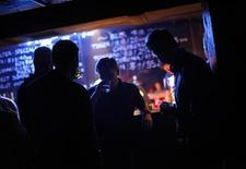 Foreigners stand at the bar area as they have a drink at The Shelter nightclub, a former bomb shelter in Xuhui district, Shanghai June 2, 2012. REUTERS/Carlos Barria