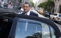 Former Goldman Sachs Group Inc board member Rajat Gupta leaves Manhattan Federal Court in New York June 8, 2012. Gupta will likely testify in his own defense at his insider trading trial, Gupta's attorney said on Friday. REUTERS/Andrew Kelly