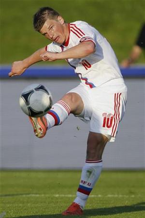 Russia's national soccer team player Andrei Arshavin kicks the ball during his international friendly soccer match against Lithuania in Nyon, May 29, 2012. REUTERS/Valentin Flauraud