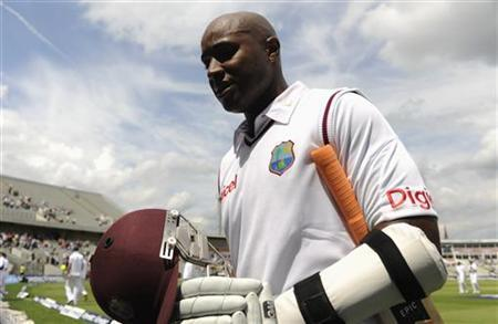 West Indies' Tino Best leaves the field after being dismissed for 95 runs during the third cricket test match against England at Edgbaston cricket ground in Birmingham June 10, 2012. REUTERS/Philip Brown