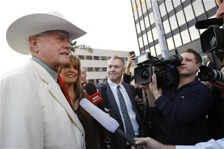Actor Larry Hagman and actress Linda Gray are interviewed as they arrive for a VIP Preview party for the Collection of Larry Hagman at Julien's Auctions in Beverly Hills, California June 1, 2011. Hagman, 79, best-known for playing conniving Texas oil baron J.R. Ewing in the television series ''Dallas,'' is putting furnishings, antiques, art work and personal property from his hilltop California home up for auction, to be held at Julien's Auctions live June 4. REUTERS/Mario Anzuoni