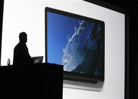 Phil Schiller, senior vice president of worldwide marketing at Apple Inc. watches video showing the new Macbook Pro during the Apple Worldwide Developers Conference 2012 in San Francisco, California June 11, 2012. REUTERS/Stephen Lam