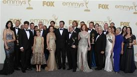 "The cast and crew of ""Mad Men,"" winner of the award for outstanding drama series, pose backstage at the 63rd Primetime Emmy Awards in Los Angeles September 18, 2011. REUTERS/Lucy Nicholson"