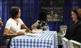 """U.S. first lady Michelle Obama attends a book signing of her first book """"American Grown"""" at a book store in Washington, June 12, 2012. REUTERS/Jason Reed"""