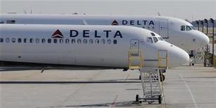 A Delta Airlines MD-88 (foreground) with Airbus A320 (background) at Hartsfield-Jackson International Airport in Atlanta , Georgia, December 9, 2011. REUTERS/Tami Chappell