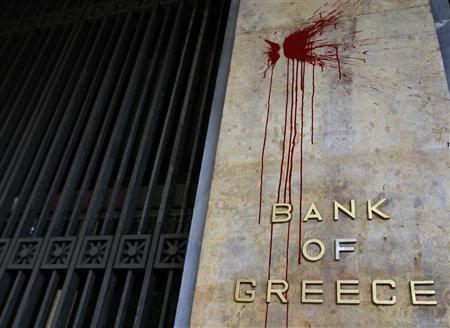 The defaced facade of the Bank of Greece is seen after a night of violence which followed the Greek parliament approval of a deeply unpopular austerity bill in Athens, February 13, 2012. REUTERS/John Kolesidis
