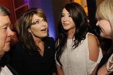 Former Governor of Alaska Sarah Palin (2nd L) talks with her daughter Bristol Palin (2nd R) as she arrives at the embassy of Italy for an MSNBC after-party following the annual White House Correspondents' Association dinner in Washington May 1, 2011. REUTERS/Jonathan Ernst