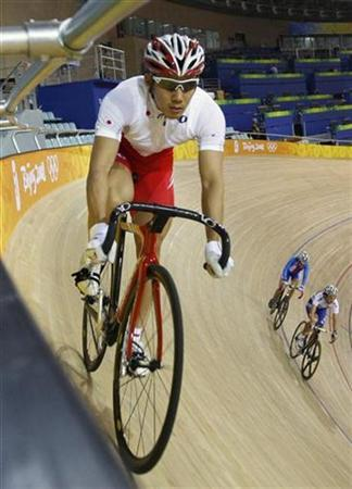 Kazunari Watanabe of Japan attends a track cycling training session during the Beijing 2008 Olympic Game August 12, 2008. REUTERS/Jacky Naegelen/Files