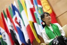 Myanmar's pro-democracy leader Aung San Suu Kyi waits before she delivers a speech during the last day of the 101st session of the International Labour Conference of the International Labour Organisation (ILO) at the United Nations European headquarters in Geneva June 14, 2012. REUTERS/Valentin Flauraud