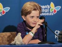 Young actor Max Page, 7, attends a news conference at Children's Hospital in Los Angeles, California June 13, 2012. REUTERS/Mario Anzuoni
