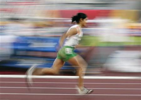 India's Pinki Pramanik competes in the women's 400m finals at the 15th Asian Games in Doha December 10, 2006. REUTERS/Jerry Lampen/Files
