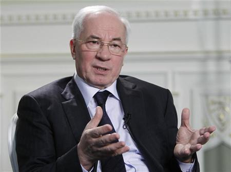 Ukraine's Prime Minister Mykola Azarov speaks during his interview with Reuters in Kiev March 12, 2012. REUTERS/Gleb Garanich