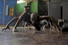 Haiti's Sephora Germain performs a dance piece during a rehearsal session in the Ayikodans dance studio in Port-au-Prince June 6, 2012. REUTERS/Swoan Parker