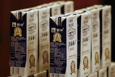 Products of China Mengniu Dairy, one of China's leading dairy products company, are displayed at a news conference announcing the company's interim results in Hong Kong September 19, 2008. REUTERS/Bobby Yip