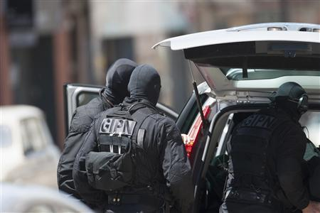 Special French GIPN intervention police arrive at the scene where a man claiming to be a member of al Qaeda has taken four hostages, including the bank manager, in a bank in Toulouse, June 20, 2012. The man took several hostages in a branch of French bank CIC and fired a shot after an attempted armed robbery apparently went wrong, a police union official reported. REUTERS-Bruno Martin