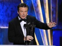"""Actor Alec Baldwin accepts the award for outstanding performance by a male actor in a comedy series for """"30 Rock"""" at the 18th annual Screen Actors Guild Awards in Los Angeles, California January 29, 2012. REUTERS/Lucy Nicholson"""