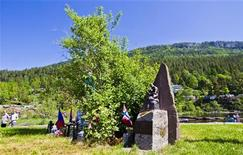 """A memorial from the Rotary Club is installed to commemorate volunteers who rescued victims from Utoeya on July 22, 2011, in Utvika May 26, 2012. Mass killer Anders Behring Breivik is a """"cowardly little man,"""" one of his teenage victims said on Wednesday, after showing a court the scars left by four bullets that had pierced her body. Breivik killed 77 people on July 22, first detonating a car bomb outside government headquarters and killing eight, then gunning down 69 people, mostly teenagers, at the ruling Labour Party's summer camp on Utoeya Island. REUTERS/ Vegard Groett / NTB scanpix"""