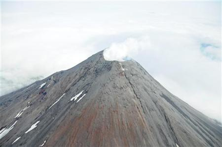 An aerial photograph shows the Cleveland Volcano during the time a small lava flow, or dome, was accumulating in the summit crater as the 660 foot wide summit crater emits a white, largely steam condensate cloud in this August 8, 2011 file photo. REUTERS/Kym Yano, National Oceanic and Atmospheric Administration/Handout