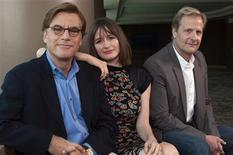 Producer Aaron Sorkin sits for a photo with cast members Emily Mortimer (C) and Jeff Daniels (R) at the offices of HBO in New York, in this May 17, 2012 file photo. REUTERS/Keith Bedford/Files