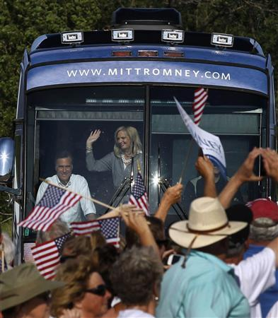 U.S. Republican Presidential candidate Mitt Romney and his wife Ann, arrive at a campaign event inside their campaign bus at Holland State Park in Michigan, June 19, 2012. REUTERS/Larry Downing