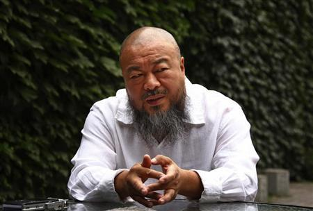 Dissident Chinese artist Ai Weiwei answers a question during an interview at his studio in Beijing May 29, 2012. REUTERS/David Gray