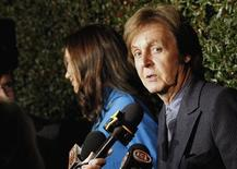 """Music recording artist Paul McCartney is interviewed as he arrives for the world premiere of the video """"My Valentine"""" directed by Paul McCartney in West Hollywood, California April 13, 2012. REUTERS/Mario Anzuoni"""