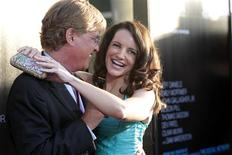 """Creator and executive producer Aaron Sorkin and actress Kristin Davis pose at the premiere of the HBO television series """"The Newsroom"""" at the Cinerama Dome in Los Angeles, California June 20, 2012. REUTERS/Mario Anzuoni"""