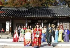 Models present traditional Hanbok during a rehearsal of an event for the spouses of leaders who will attend the G20 Seoul Summit, at Changdeokgung Palace in Seoul November 9, 2010. REUTERS/Truth Leem