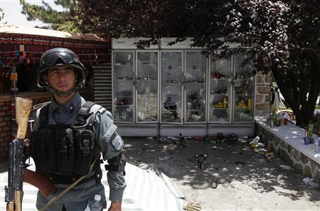Twenty dead in Taliban siege of Afghan hotel; NATO blames Haqqanis