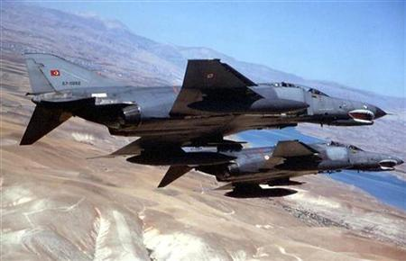 Two Turkish military F4 jets are seen in this undated file photo. REUTERS/Stringer