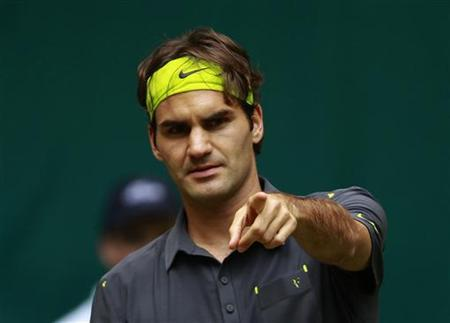 Roger Federer of Switzerland reacts during his match against Milos Raonic of Canada at the Halle Open ATP tennis tournament in Halle June 15, 2012. REUTERS/Ina Fassbender