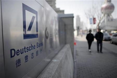 A Deutsche Bank sign is seen outside of a corporate building in Shanghai's financial district February 23, 2011. REUTERS/Carlos Barria