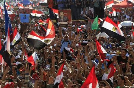 Supporters of Muslim Brotherhood's presidential candidate Mohamed Morsy celebrate his victory at the election at Tahrir Square in Cairo June 24, 2012. REUTERS/Ahmed Jadallah
