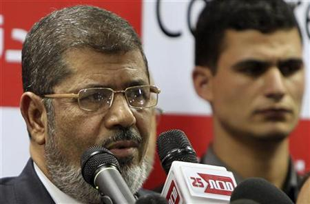 Muslim Brotherhood's Mohamed Morsi addresses a news conference in Cairo June 18, 2012. REUTERS/Suhaib Salem