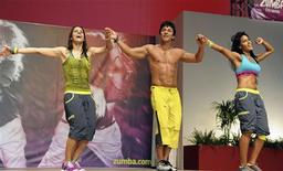 Alberto Perez (C), founder of Zumba Fitness, performs on stage during a meeting in Rimini, central Italy May 11, 2012. REUTERS/Stringer