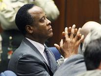 Dr. Conrad Murray sits in court after he was sentenced to four years in county jail for his involuntary manslaughter conviction of pop star Michael Jackson in Los Angeles November 29, 2011. REUTERS/Mario Anzuoni