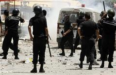 Riot police chase after protesters in the Ettadhamen district of the capital Tunis in this June 12, 2012 file photo. REUTERS/Zoubeir Souissi/Files