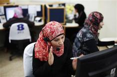A woman from the Bedouin community works at a call centre housed in a mosque in Hura, southern Israel April 18, 2012. REUTERS/Amir Cohen