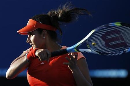 Sania Mirza hits a return at a match at the Australian Open tennis tournament in Melbourne January 16, 2012. REUTERS/Vivek Prakash/Files