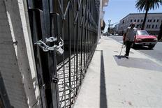 Shuttered and padlocked businesses line Main Street in Stockton, California June 27, 2012. REUTERS/Kevin Bartram