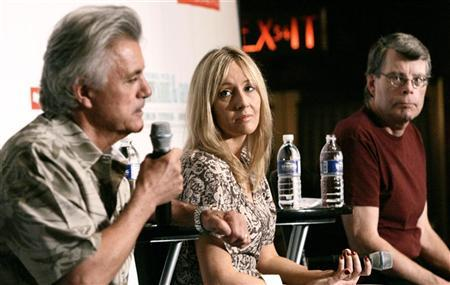 Authors J.K. Rowling (C), John Irving (L) and Stephen King attend a news conference together before a charity reading event in New York, August 1, 2006.
