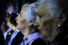 Hava Hershkovitz, 79, (2nd R), a Holocaust survivor and winner of a beauty contest for survivors of the Nazi genocide, stands with other contestants during a contest in the northern Israeli city of Haifa June 28, 2012. REUTERS/Avishag Shar-Yashuv
