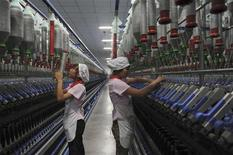 Uighur ethnic minority employees work at the production line of a textile mill in Aksu, Xinjiang Uyghur Autonomous Region March 31, 2012. REUTERS/Stringer