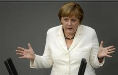 German Chancellor Angela Merkel delivers her speech before the vote for the ratification of the European Union fiscal pact at the Reichstag, the seat of the German lower house of parliament, the Bundestag, in Berlin, June 29, 2012. REUTERS/Fabian Bimmer