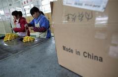 <p>L'activité manufacturière en Chine s'est contractée en juin à son rythme le plus marqué en sept mois, plombée par des commandes à l'exportation, selon la version définitive de l'indice PMI calculé par la banque HSBC. /Photo d'archives/REUTERS/Carlos Barria</p>
