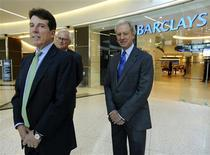 Barclays PLC President Bob Diamond (L) poses for photographs with CEO John Varley and Chairman Marcus Agius (R), after being named as the company's next chief executive officer at a bank branch near their Canary Wharf headquarters in London in a September 7, 2010 file photo. Barclays announced the resignation of Agius on July 2, 2012. REUTERS/Dylan Martinez/files