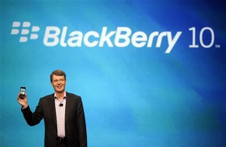 Research in Motion Chief Executive Officer Thorsten Heins holds up a prototype of the BlackBerry 10 smartphone at the BlackBerry World event in Orlando May 1, 2012 . REUTERS/David Manning