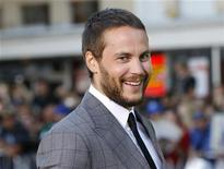 """Cast member Taylor Kitsch arrives at the premiere of the film """"Savages"""" in Los Angeles June 25, 2012. REUTERS/Danny Moloshok"""