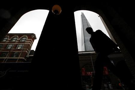 The Shard, Europe's tallest building is seen through an archway next to London Bridge station in central London, July 3, 2012. REUTERS/Andrew Winning